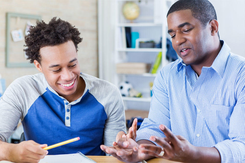 African-American male student meeting with African-American male mentor.