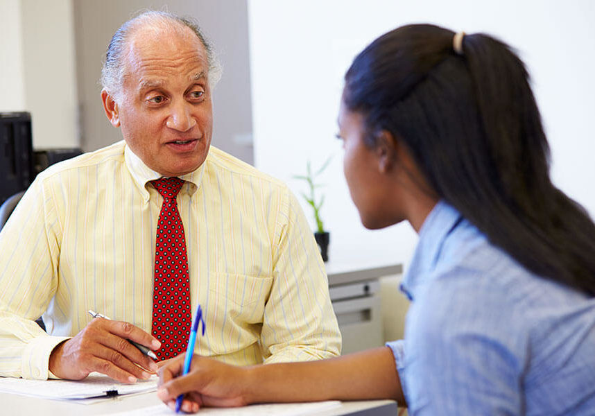 Male counselor talking to female student