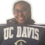 Remy holding a UC Davis shirt
