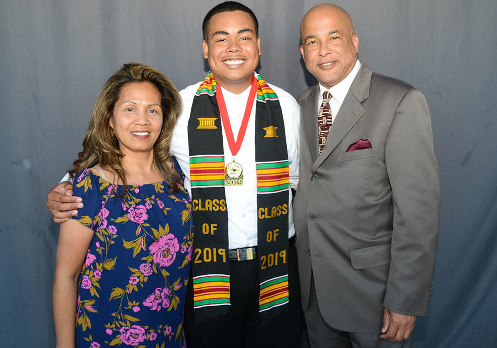 High school graduate with parents